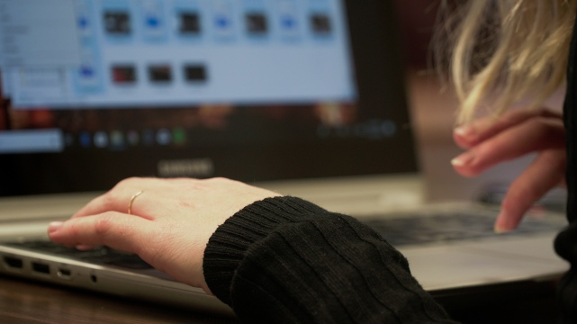 Alex Ogle edits photos for her portfolio. Her portfolio will be reviewed for her PJ class. Wednesday, November 28, 2018. Photo by: Katie Haremski